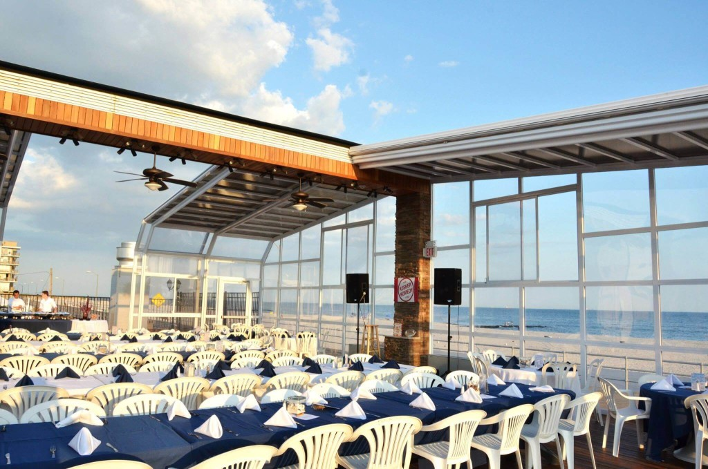Kosher Komedy took place in a beautiful glass atrium overlooking the Atlantic Ocean at Sunny Atlantic Beach Club.